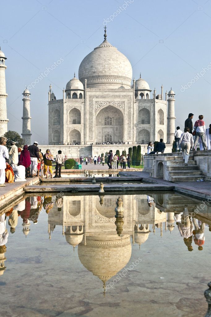 AGRA, INDIA - NOVEMBER 16: Indian tourists walk around the Taj Mahal on November 16,2011 in Agra, India. It is an UNESCO World Heritage site and is an example o — Stock Photo #8898268
