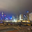 Stock Photo: Hong Kong Harbor Laser Show to Skyline of Victoria