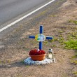 Cross for the young man Gregor who died at that place in a traff — Stock Photo