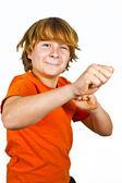 Happy boy in Studio simulating a box fight — Stock Photo
