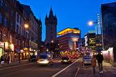 Rush hour downtown Frankfurt with view to the Eschesheimer Turm — Stock Photo