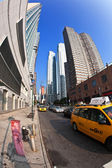 Taxi in 42 street with view to skyscrapers. — Stock Photo