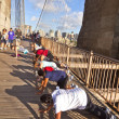 Are doing push-up exercises at the Brooklyn bridge - Stock Photo