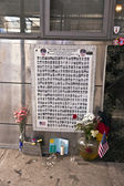 Poster in Memorial to the brave Firemen which died in 911 — Stock Photo