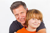 Father and happy son hugging — Foto Stock