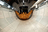 Inside the space shuttle Explorer with a satellite as load in th — Stock Photo