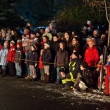 Audience at a fire spectacle at night — Stock Photo