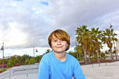 Happy boy with scooter at the skatepark — Stock Photo