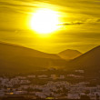 Sunset over village of Yaiza in Lanzarote — Stock Photo