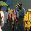 Priest carries the holy ark in a ceremony through the streets - Stok fotoraf