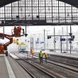 Worker repair catenary in station — Stock Photo #9389235