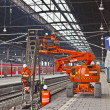 Worker repair the catenary in the station — Stock Photo #9389642