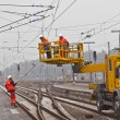 Stock Photo: Worker repair the catenary in the station