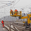 Worker repair the catenary in the station — Stock Photo #9389744