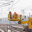 Worker repair the catenary in the station — Stock Photo #9389767