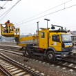 Worker repair catenary in station — Stock Photo #9389931