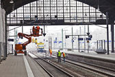 Worker repair the catenary in the station — Stock Photo