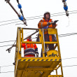Worker repair catenary in station — Stock Photo #9390245