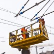 Worker repair the catenary in the station — Stock Photo #9390337