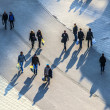 Walking at the street with long shadows - 图库照片