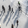 Walking at the street with long shadows - Stock Photo