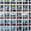 Stock Photo: Facade of office building with reflection of street life