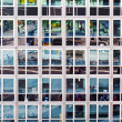 Facade of office building with reflection of street life — Stock Photo