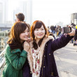 Japanese tourists take self-portraits — Stockfoto