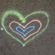 Heart painted on the street - Stock Photo