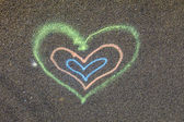 Heart painted on the street — Stock Photo