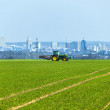 Tractor on the field with Skyline of Frankfurt — Stock Photo