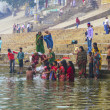 hindu wash themselves in the river ganga in the holy cit — Stock Photo