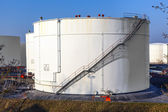 White tank in tank farm with blue sky — Stock Photo