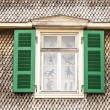 Open window in old house with wooden tiles — Stock Photo #9670675