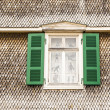 Open window in old house with wooden tiles — Stock Photo