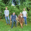 Extended family group posing in the garden with grandparents — Stock Photo #9691253