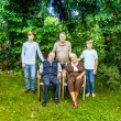 Extended family group posing in the garden with grandparents — Stock Photo #9691278