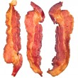 Cooked bacon strips - Stock Photo