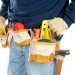 Man wearing tool belt - Stock Photo
