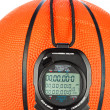 Basketball and stopwatch - Stock Photo