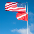 American and scuba flag blowing in wind — Stock Photo