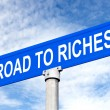 Stockfoto: Road to Riches Street Sign