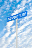 Prosperity street sign against sky — Stock Photo