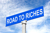 Road to Riches Street Sign — Stockfoto