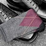 Black leather shoes with Argyle socks — Stock Photo #8929992