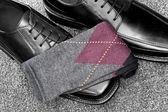 Black leather shoes with Argyle socks — Stock Photo