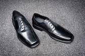 Black leather dress shoes — Stock Photo