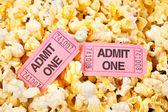 Movie tickets and popcorn — Stock Photo