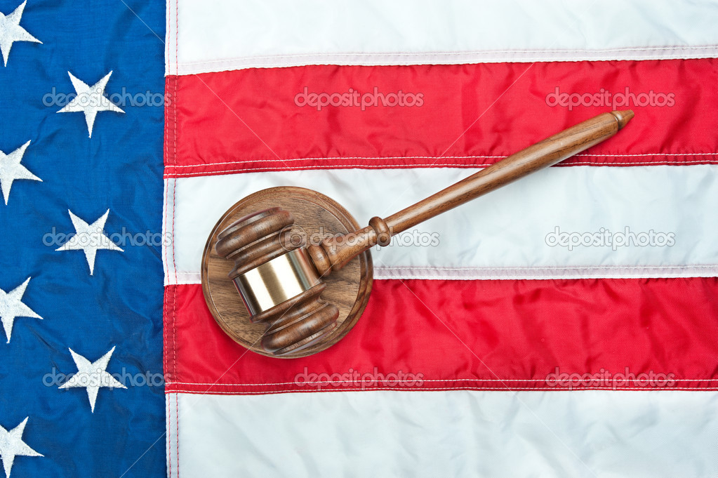 A gavel and sound block on an American flag representing the legal system and any law inference in the USA — Stock Photo #8930300