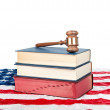 Gavel and books on American flag — Stock Photo